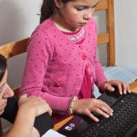 Girl working on computer with tutor 2020 05 13
