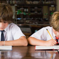 Two boys working in library 200527 070551